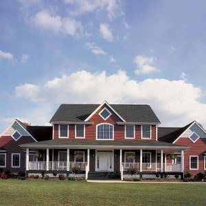 red barn house in Columbus Ohio where the siding was replaced by Benchmark roofing