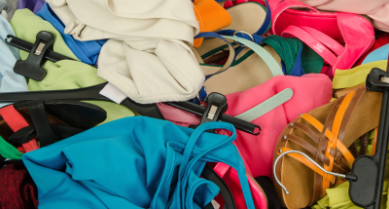 piles of clothes and shoes