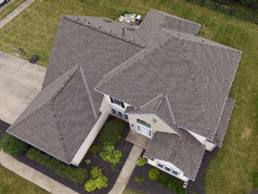 Image of a luxury home in Columbus Ohio with a brand new gray roof from Benchmark Roofing